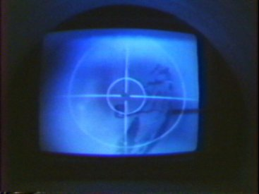The viewing monitor with an image of Malcolm Fraser printed onto one of the balloons in a cctv camera shot.