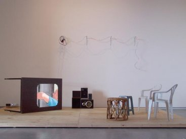 Doubleday 2008  lights, found table, chairs, speakers and amplifier, data projector and timber, animation 4:16 minutes looped, installation view at TarraWarra Museum of Art, Healsville, Victoria 480.0 x 240.0 x 240.0 cm