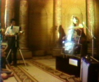 Paik and Moorman during a performance of the TV Cello in the entrance hall of the AGNSW (video still from photograph: Stephen Jones)