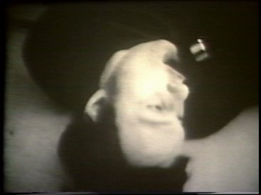 Still from Sequence 10 of Idea Demonstrations. Mike Parr holds his breath for as long as possible.