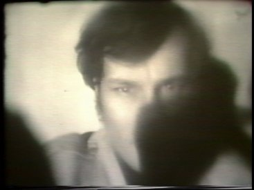 Still from Sequence 1 of Idea Demonstrations. Mike Parr performing Indefintion Transference