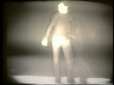 Still from Sequence 4 of Idea Demonstrations. Peter Kennedy filling the outline of Aggy Read.