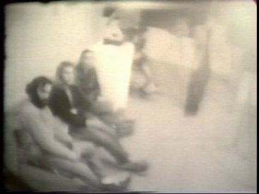 Still from Sequence 6 of Idea Demonstrations. A camera is used to measure the height of the room.
